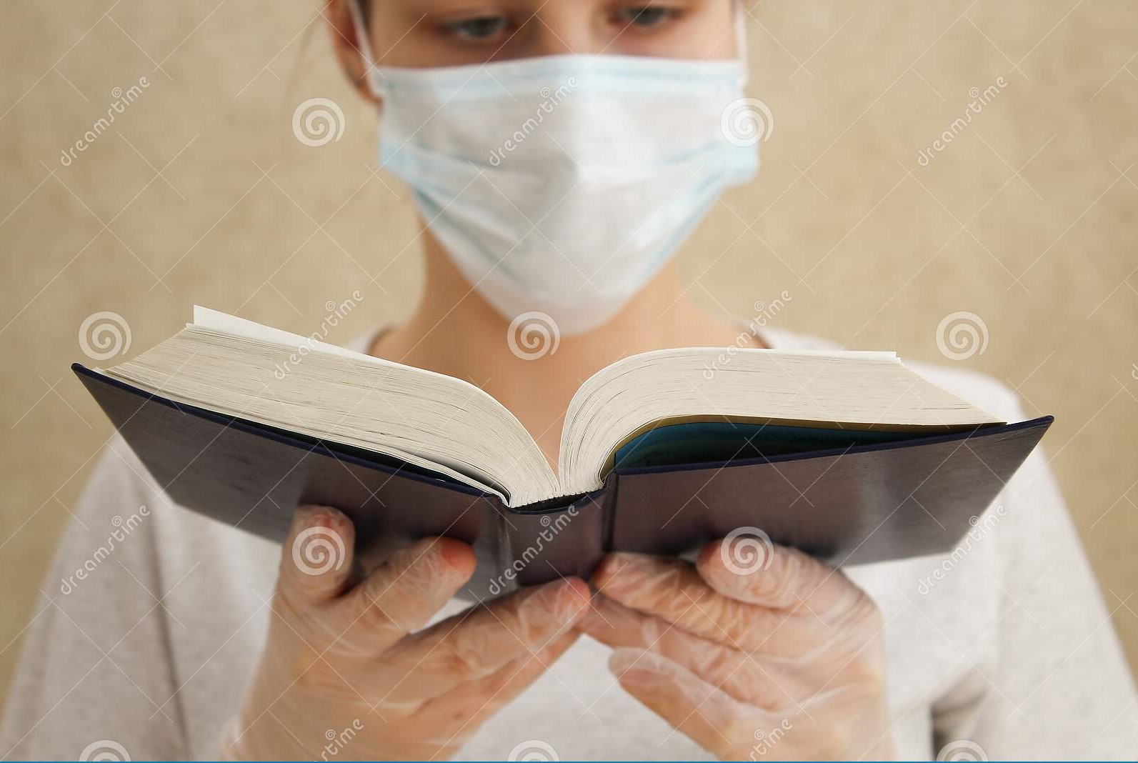 young woman medical mask gloves book home quarantine coronavirus outbreak self isolation pandemic world flu virus 177054207